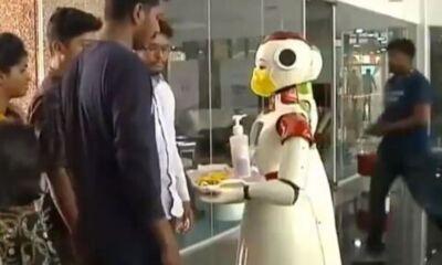 Robots distributing sanitizers in kerala