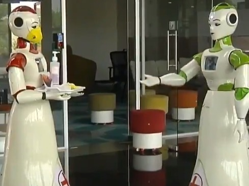 Robots distributing sanitizers in kerala