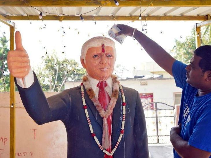 Indian man worships Donald Trump